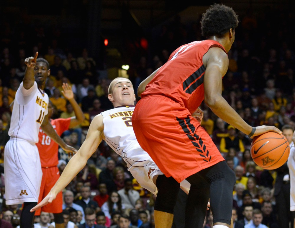 Minnesota Forward Joey King takes a charge against Rutgers in the first half at Williams Arena on Saturday, January 17, 2015.  King caused three charges.