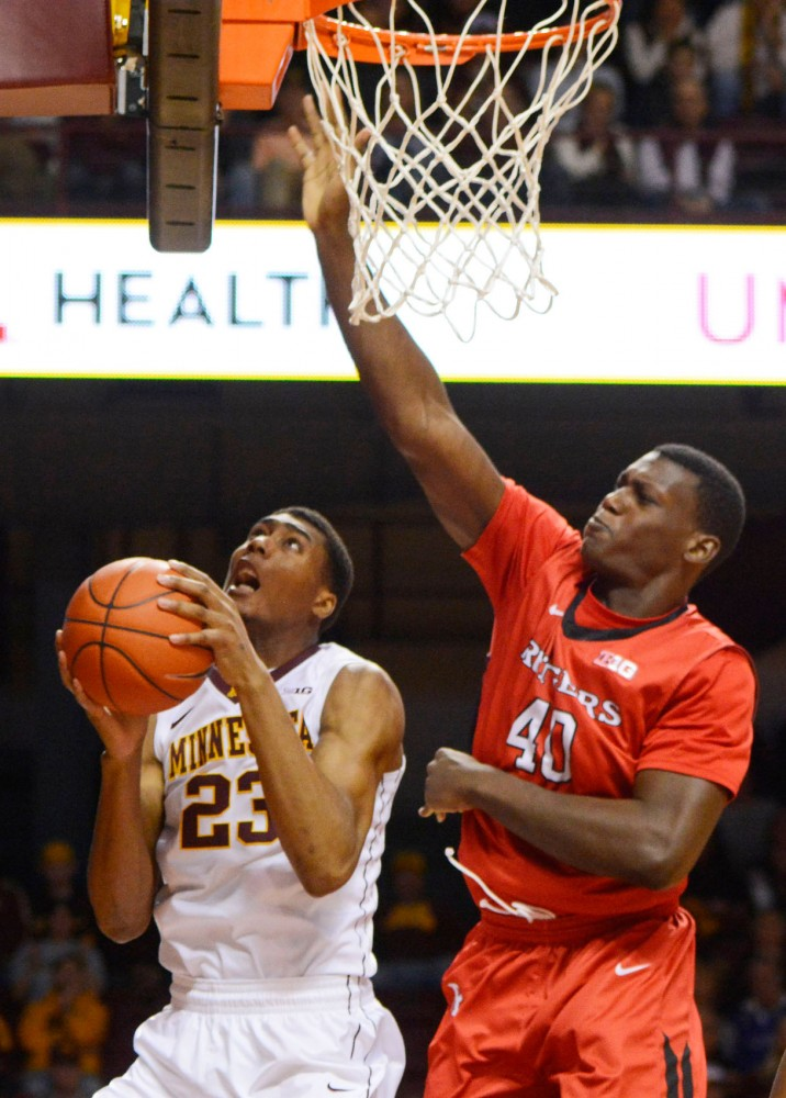 Minnesota forward Charles Buggs is defended by Rutgers center Shaquille Doorson as he goes up for a shot in the second half at Williams Arena on Saturday, January 17, 2015.