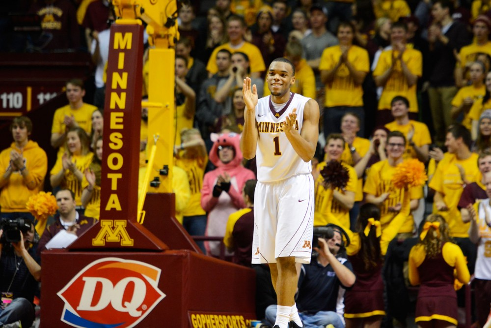 Minnesota guard Andre Hollins claps after scoring his seventh three-pointer against the Rutgers in the second half at Williams Arena on Saturday, January 17, 2015.  Hollins scored a season high of 31 points.
