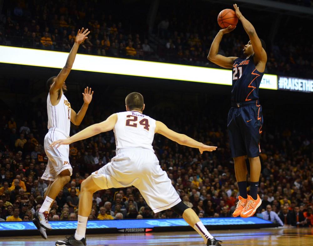 Illinois guard Malcom Hill shoots the ball on Saturday at Williams Arena.
