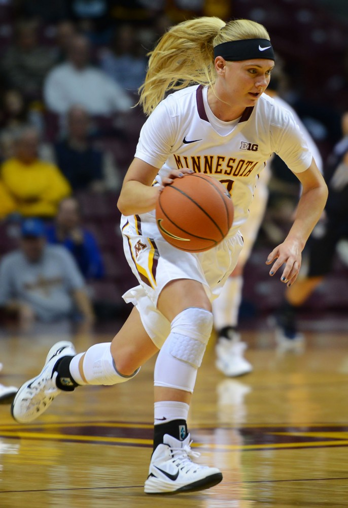 Freshman guard Carlie Wagner runs down the court at Williams Arena on Dec. 7, 2014, against Butler.
