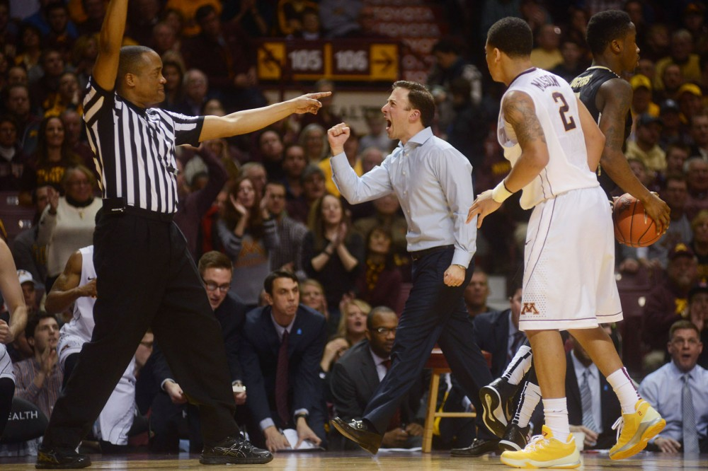 Minnesota Head Coach Richard Pitino celebrates after the Gophers caused Purdue to turn over the ball in the second half at Williams Arena on Saturday. Minnesota beat Purdue 62-58.