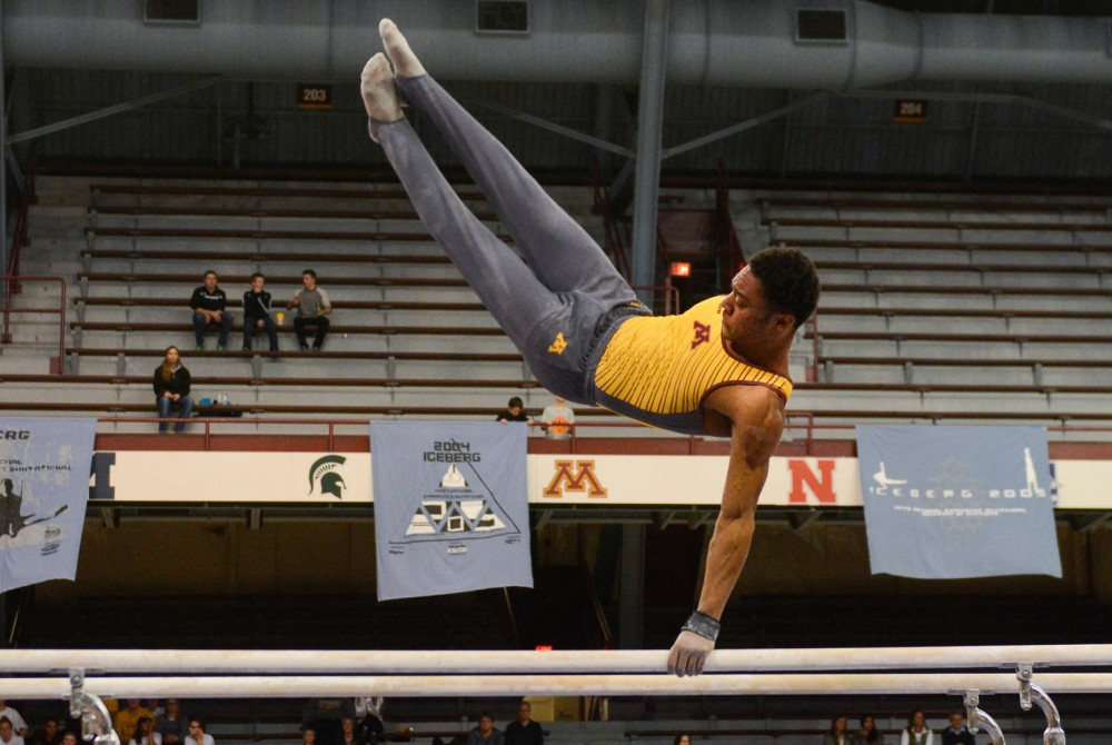 Paul Montague performs on the parallel bars on Saturday at Sports Pavilion.