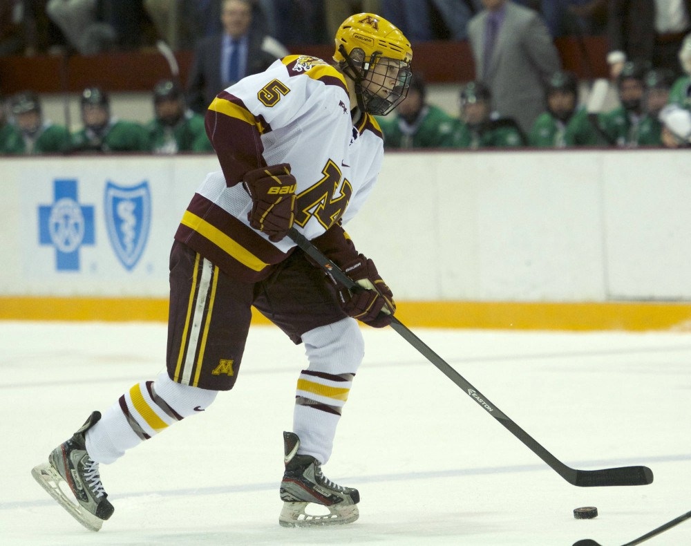 Minnesota defenseman Rachel Ramsey prepares to pass the puck against North Dakota on Saturday, Nov. 16, 2013.