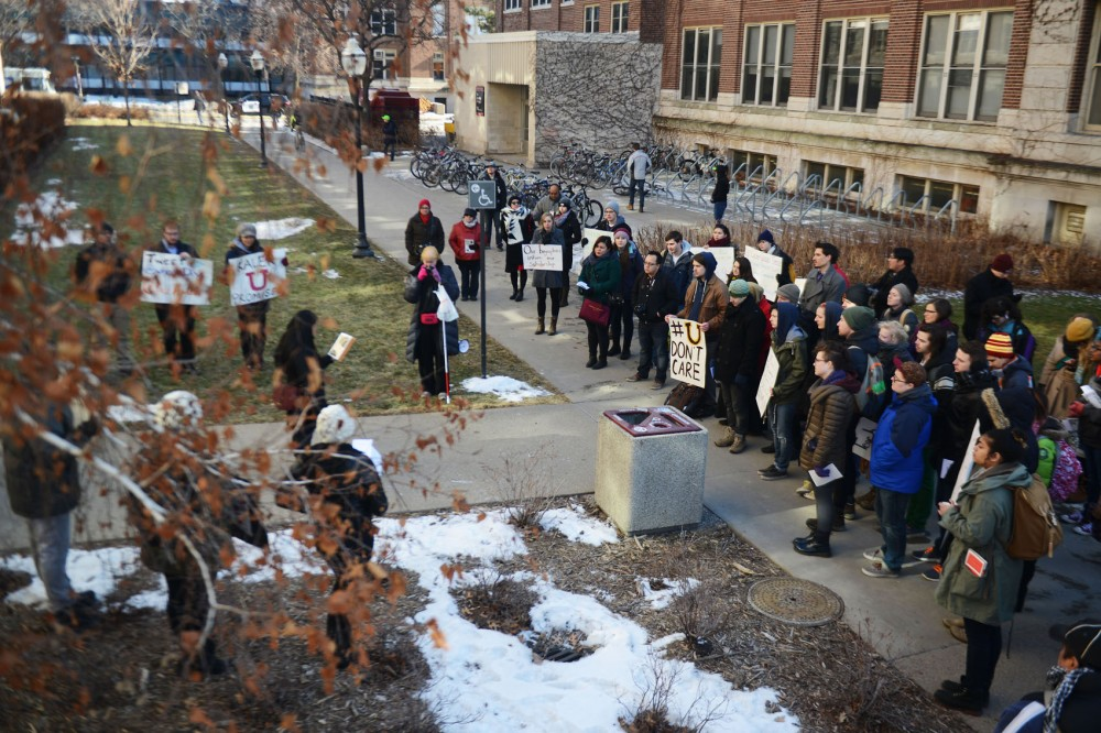 A crowd of demonstrators gather outside of Morril Hall on Monday afternoon, where demonstrators occupied the campus building in demand of more diversity within the University of Minnesota.