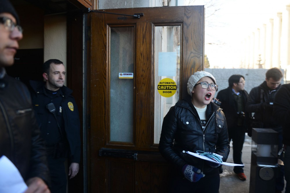 Demonstration leader Tori Hong leads a crowd of protestors to the doors of Morril Hall on Monday afternoon, where campus police prevented access to the building. Demonstrators occupied the campus building in demand of more diversity within the University of Minnesota.