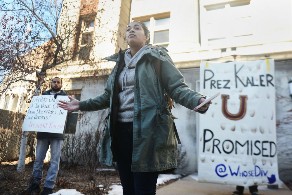 Mica Grimm of Black Lives Matter Minneapolis speaks to a crowd of demonstrators outside Morril Hall on Monday afternoon, where demonstrators occupied the campus building in demand of more diversity within the University of Minnesota.