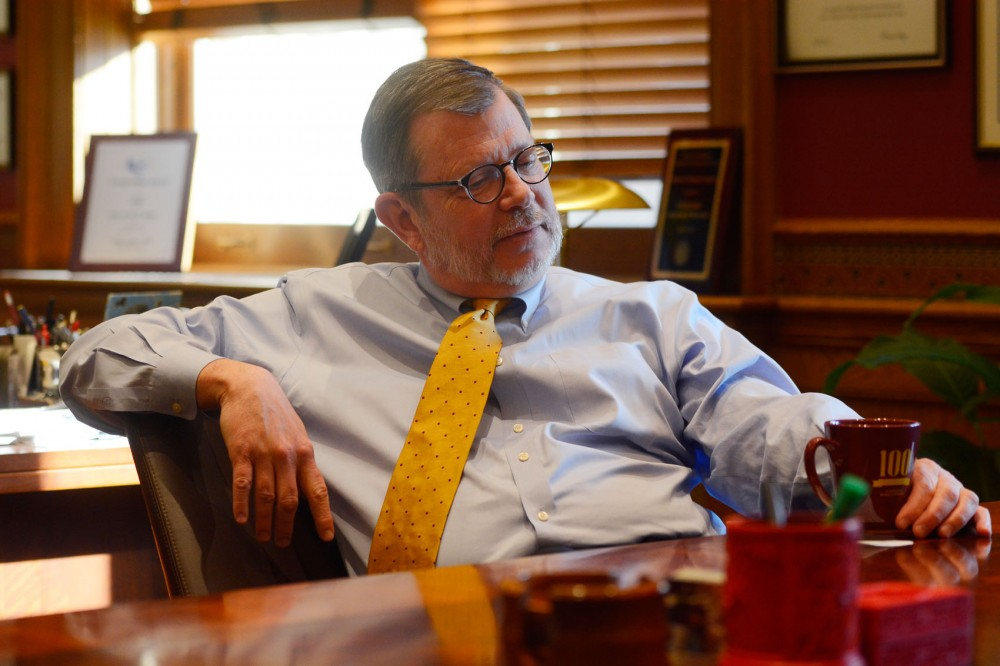University of Minnesota President Eric Kaler sits in his office in Morrill Hall on Friday to discuss Gov. Mark Dayton's budget proposal. The governor's plan only funds half of the school's requested amount for a tuition freeze for undergraduate students who pay in-state tuition and resident graduate students.