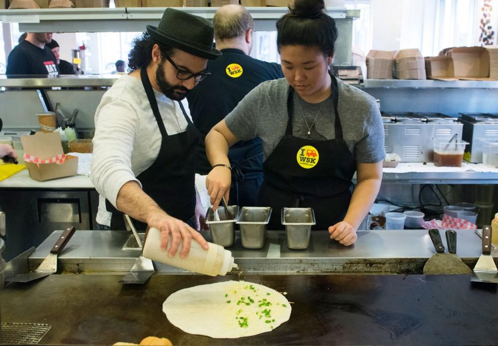 College Kitchenista Yena Lee learns how to make a kimchi quesadilla with World Street Kitchens Head Chef Wadi.