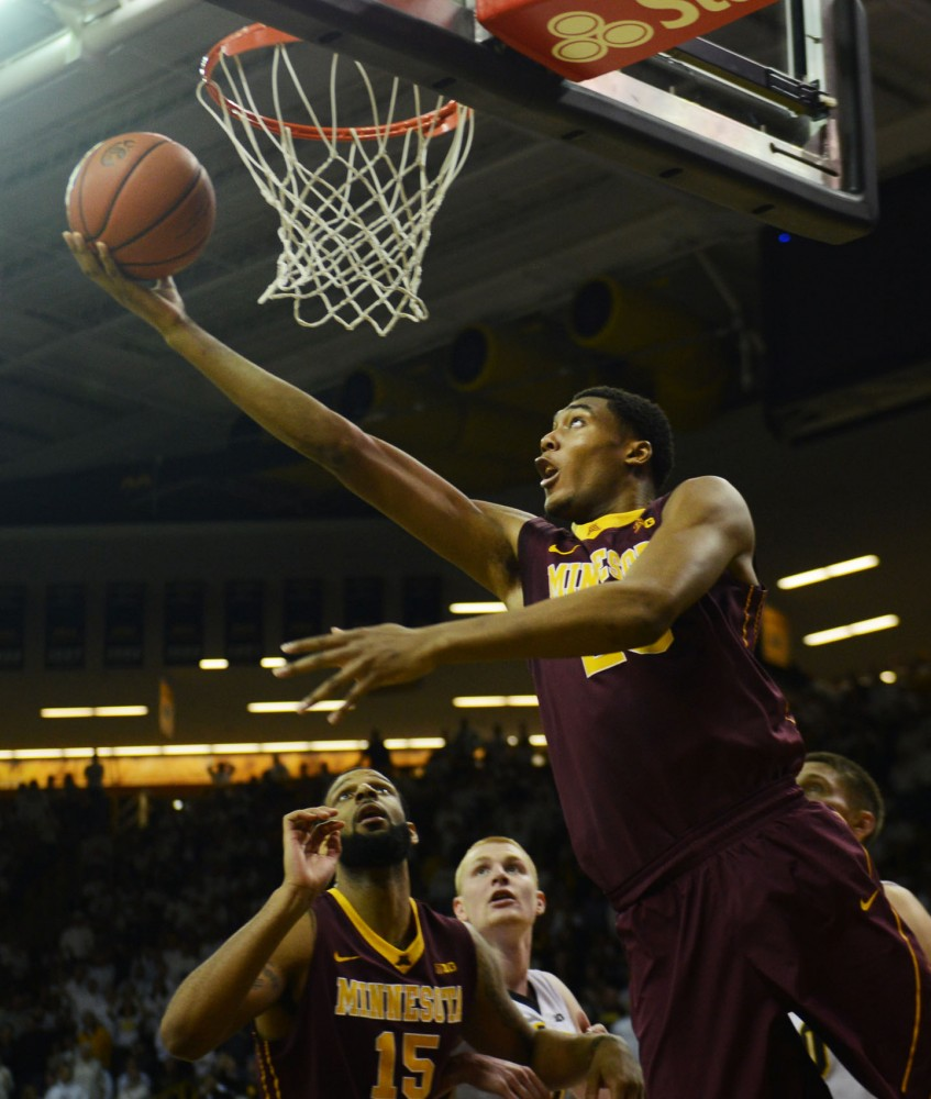 Minnesota forward Charles Buggs goes in for a layup against Iowa on Thursday night in Iowa City, Iowa.