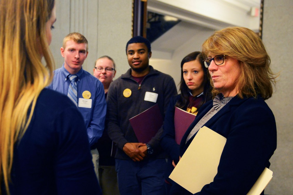 Rep. Erin Murphy, DFL-St. Paul, talks to a group of University students on Thursday afternoon. Both undergraduate and graduate students attended Support the U Day at the Capitol.