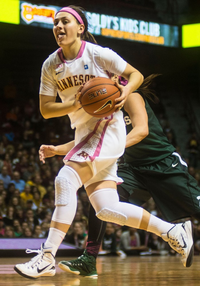 Junior Shayne Mullaney looks to pass at Williams Arena against Michigan State on Feb. 8.