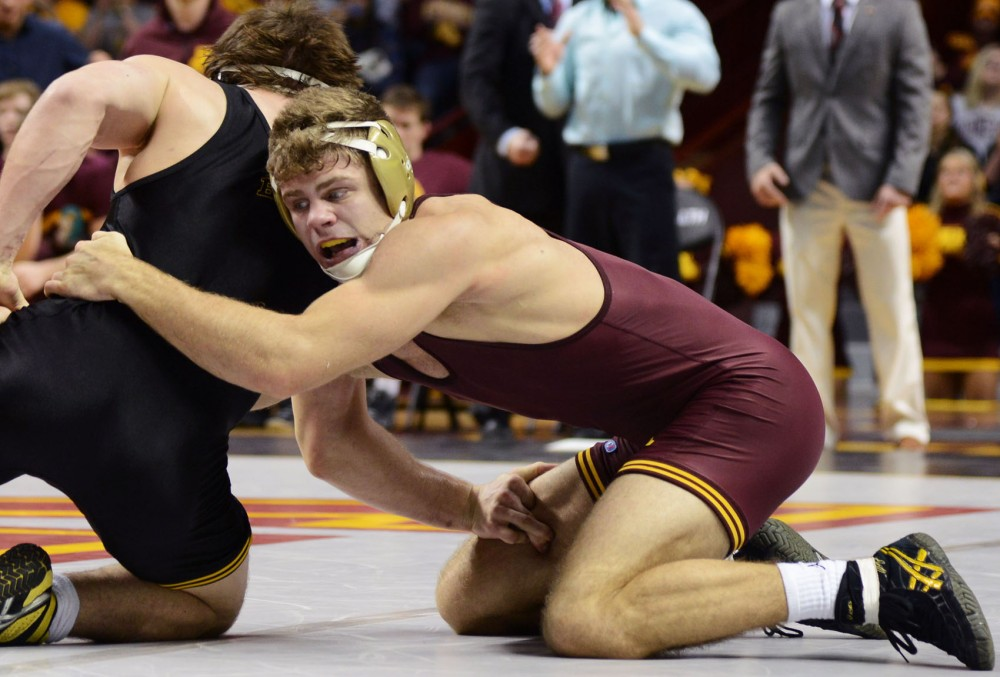 Redshirt senior Dylan Ness wrestles during his match in the Williams Arena on Friday, Jan. 30 against the Iowa Hawkeyes.