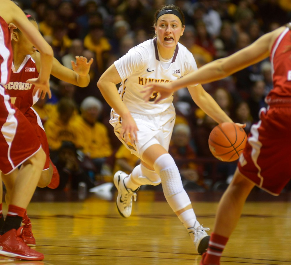 Junior Shayne Mullaney maneuvers the ball down the court at Williams Arena on Wednesday against Wisconsin.