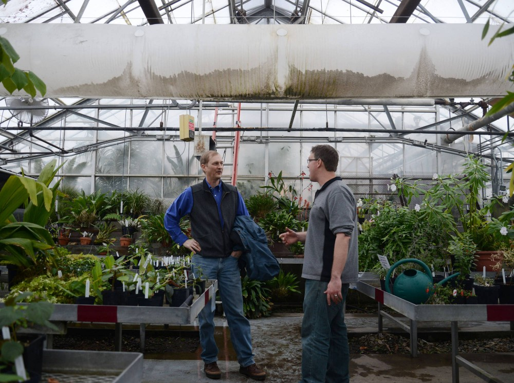 Greenhouse curator Alex Eilts and Head of the Plant Biology department Gary Muehlbauer talk in the College of Biological Sciences Greenhouse in St. Paul on Monday. There is currently a legislative request to build a new Greenhouse.