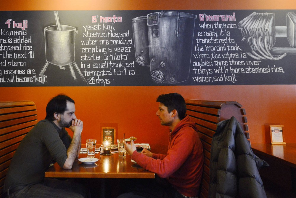 Pete and Chris Jones eat at moto-i Ramen and Sake House in Uptown on Wednesday. Moto-i is one of many restaurants participating in Minneapolis-St. Paul Magazines Restaurant Week.