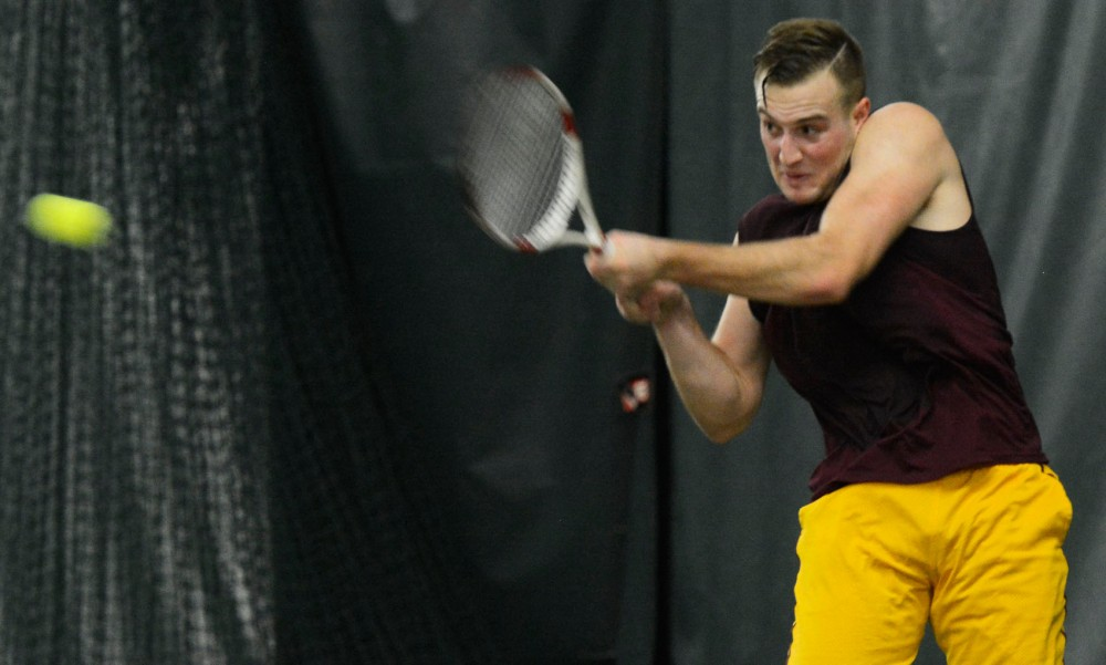 Men's Gopher Tennis player senior Jack Hamberg plays at the Baseline Tennis Center Friday night. The tennis team played Green Bay, Dartmouth, and Oklahoma State over the weekend.