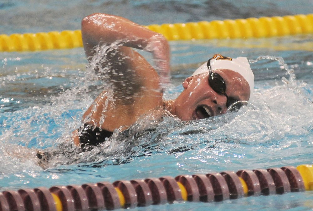 Brook Zieger swims the 1,000-yard freestyle for the Gophers at the University Aquatic Center on Friday, January 30th.