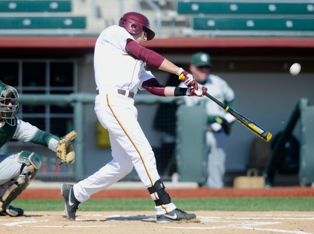 Gophers second baseman Connor Schaefbauer bats against Michigan State on March 29, 2014, at Siebert Field.