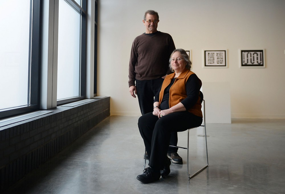 James Henkel, left, and Joyce Lyon pose together inside their exhibit entitled