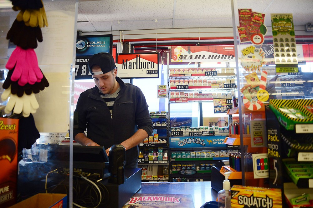 Sophomore Mohamed Khatib works at Adam's Food and Fuel, his family's business, in Roseville on Sunday.  Khatib wants to major in business marketing education and says his experience with the family business will help him in the future.