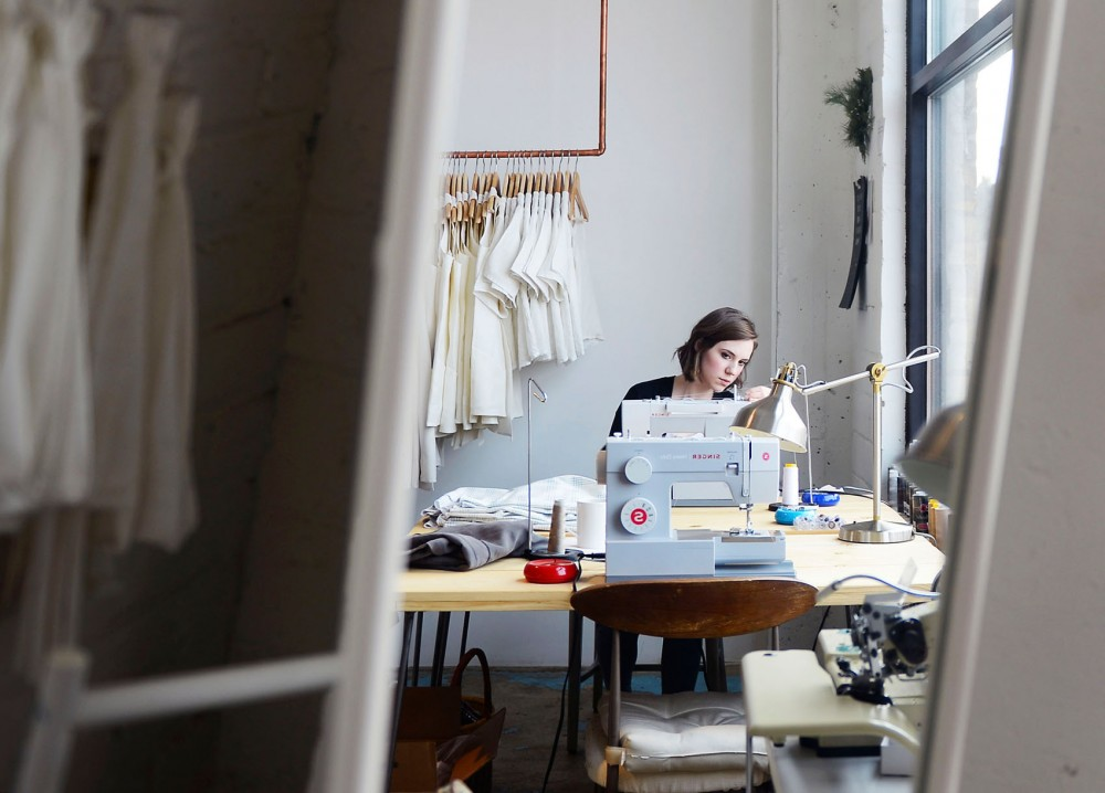 Seamstress Jenna Eddy works at a sewing machine in the Hackwith Design House studio in the North Loop of Minneapolis on Wednesday afternoon.