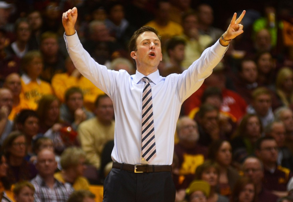 Head basketball coach Richard Pitino signals to his players from the sidelines at the Williams Arena against Nebraska on Saturday evening.