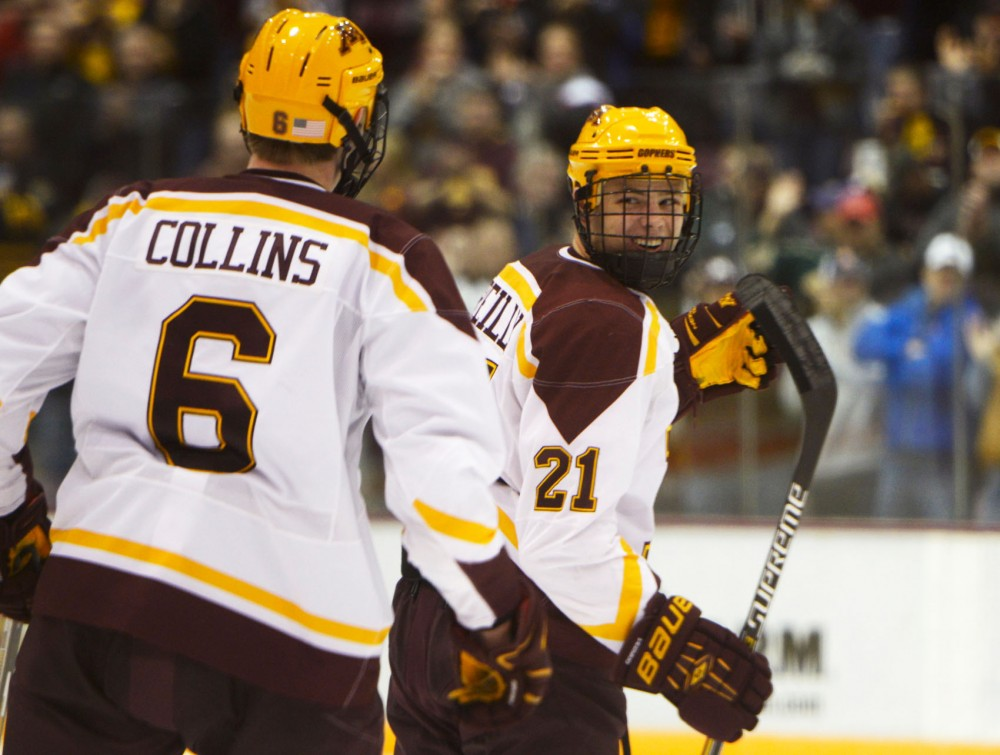 Sophomore forward Connor Reilly smiles with teammate Ryan Collins after scoring a goal during the Gopher Mens Hockey game against St. Cloud State University on Saturday evening at the Mariucci Arena.