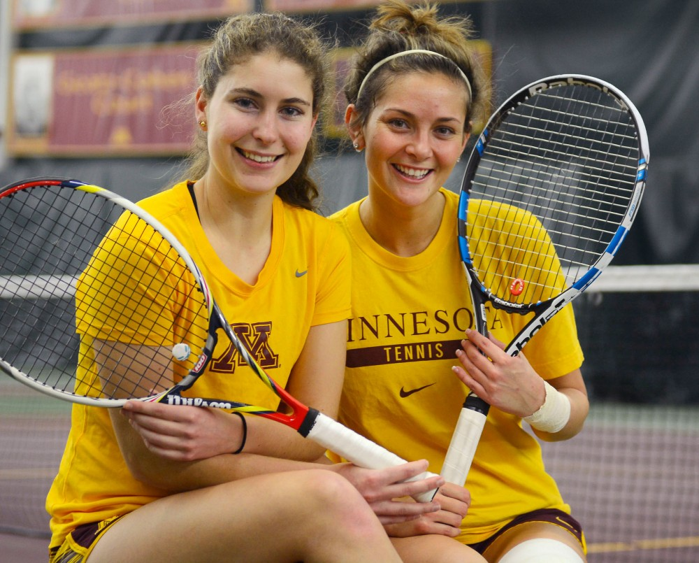 Gophers sophomore Paula Rincon-Otero, left, and junior Julia Courter pose at the Baseline Tennis Center Tuesday afternoon. The two have gotten off to a strong start in doubles this season.