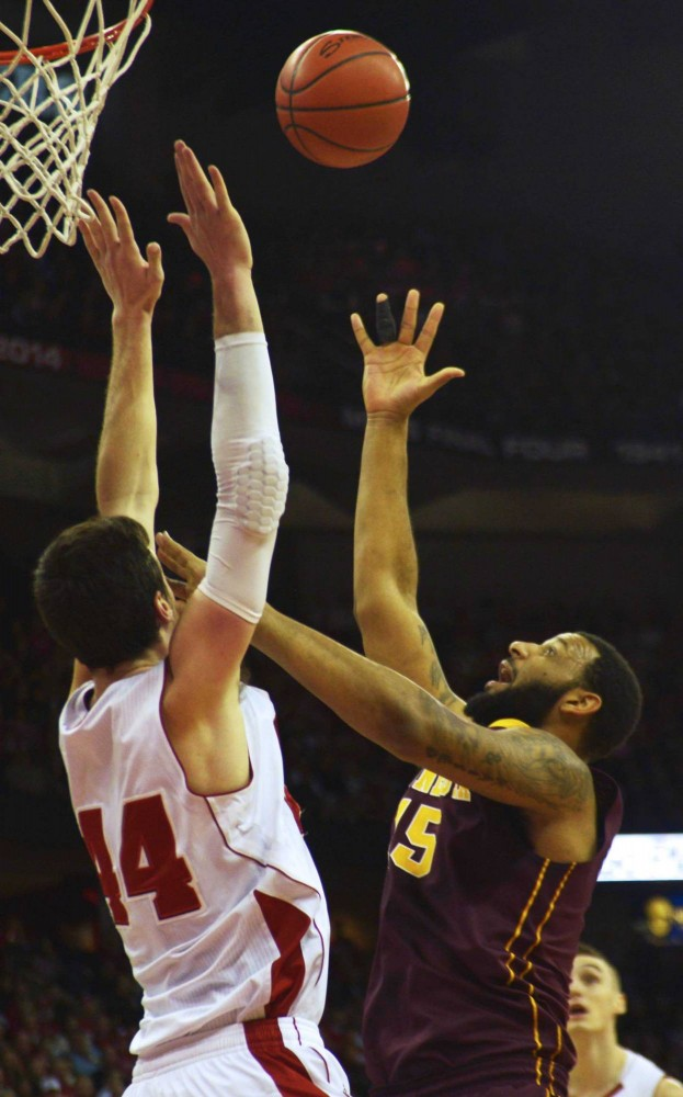 Minnesota guard Maurice Walker grabs for the rebound in the first half against the Badgers on Saturday in Madison, Wis.