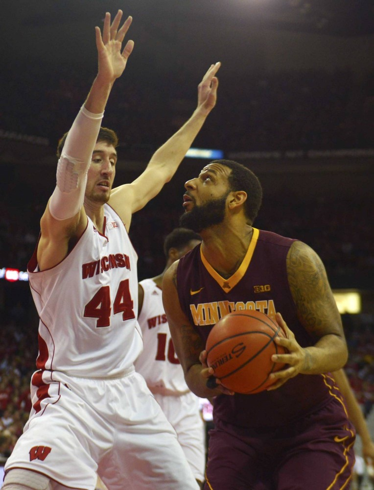 Minnesota guard Maurice Walker looks to shoot the ball  in the first half against the Badgers on Saturday in Madison, Wis.