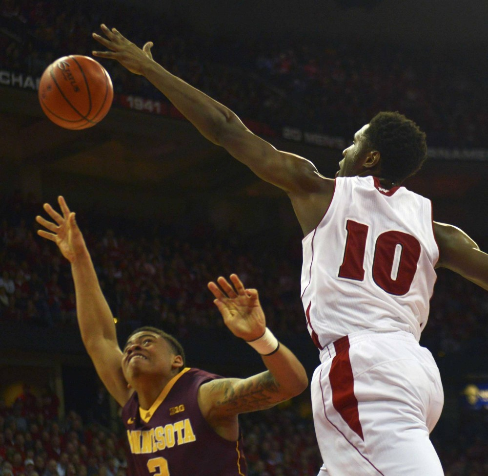 Minnesota guard Nate Mason is blocked by Wisconsin forward Nigel Hayes in the second half against the Badgers on Saturday in Madison, Wis.