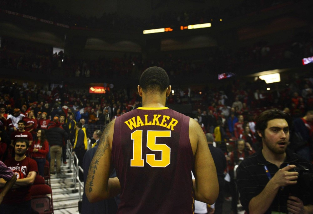 Minnesota forward Maurice Walker exits the court after losing to the Badger's 63-53 at Kohl Center in Madison, Wis.