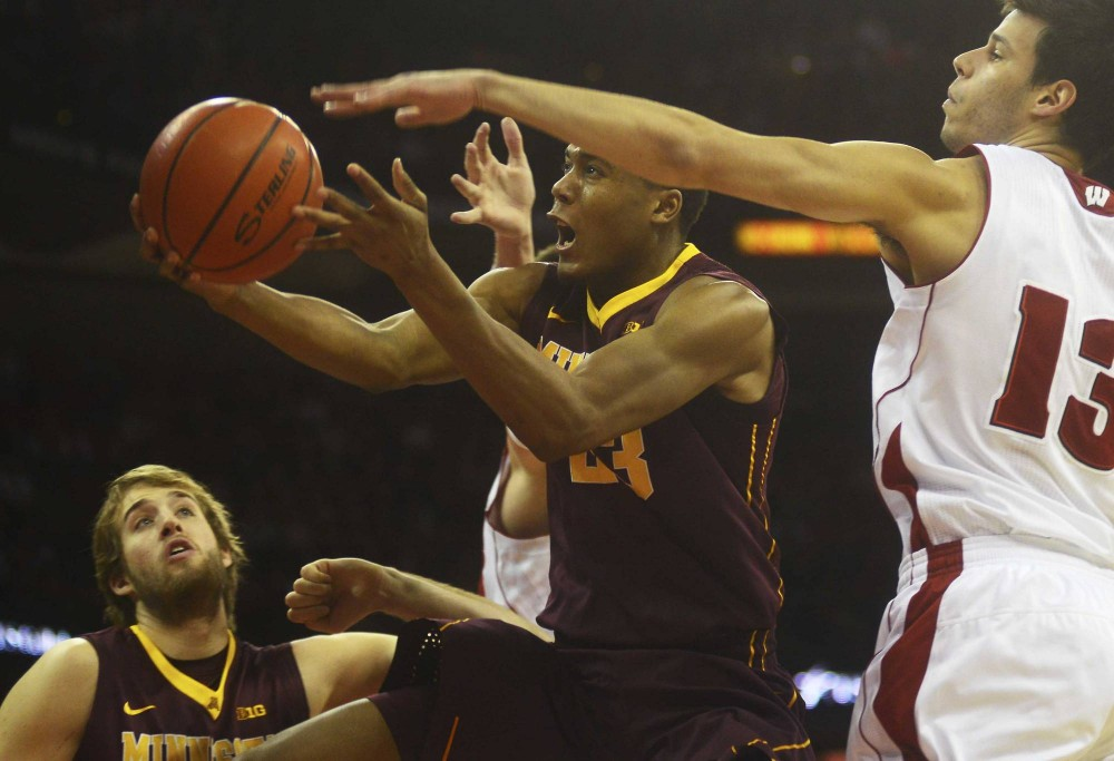 Minnesota forward Charles Buggs shoots the ball against the Badgers on Saturday in Madison, Wis.