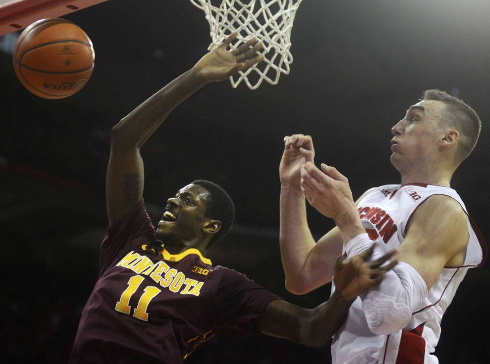 Minnesota guard Carlos Morris shoots the ball in the first half against the Badgers on Saturday in Madison, Wis.