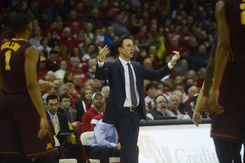 Head coach Richard Pitino calls for the team to come in for a timeout on Saturday in Madison, Wis.