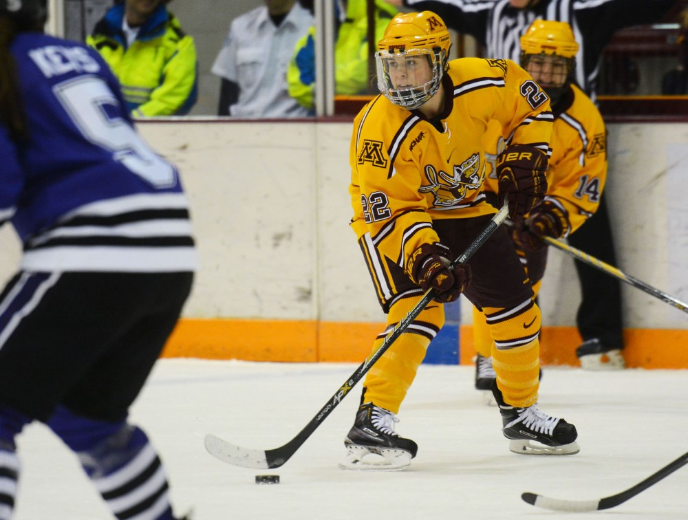 Minnesota forward Hannah Brandt handles the puck against the Mavericks at Ridder Arena on Saturday. The University beat MSUM with a final score of 5-1.