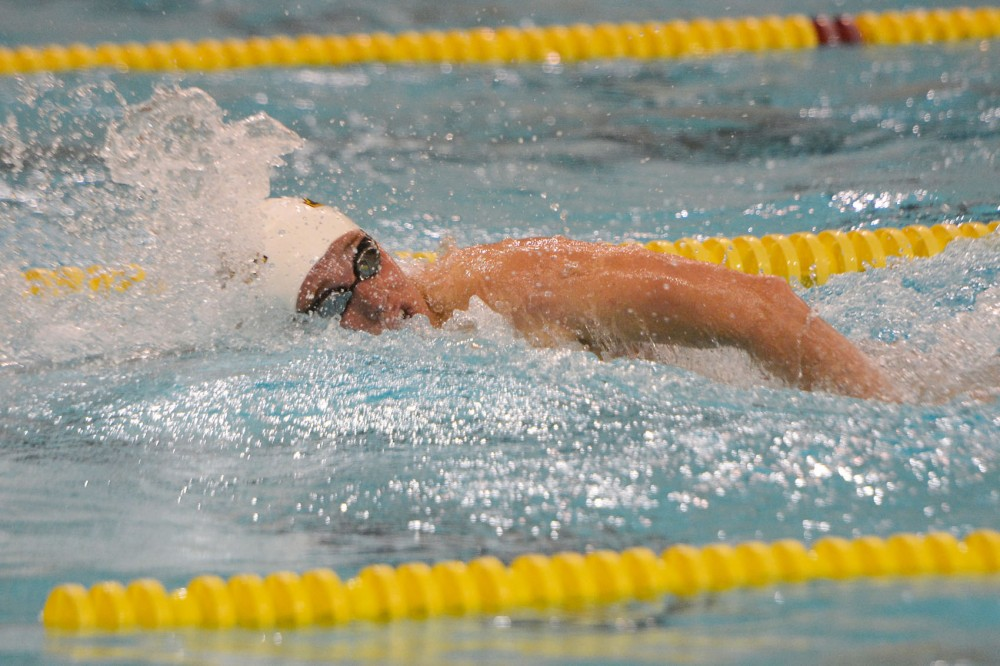 Minnesota swimmer CJ Smith swims at the University Aquatic Center against Wisconsin on Oct. 17, 2014.