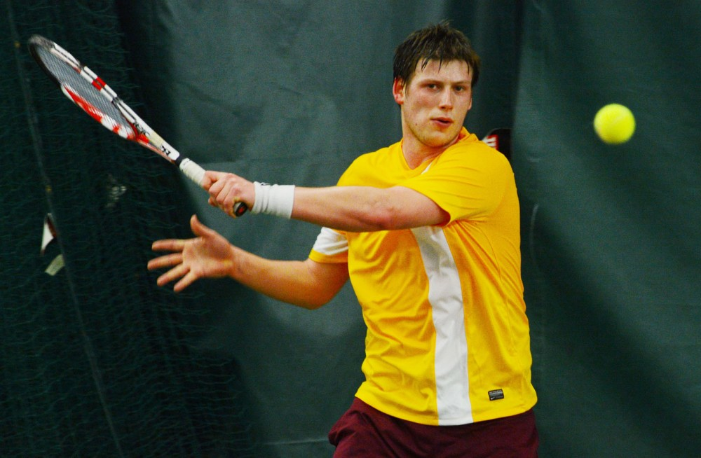 Minnesota's Leandro Toledo returns a volley from his Marquette opponent at the Baseline Tennis Center on Jan. 31, 2014.