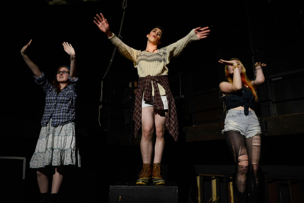 EF! The Musical cast members Katie Korpi (left), Ian Meyer and Rachel Chevremont act out a scene during their dress rehearsal in the Nolte Experimental Theatre in the Rarig Center on West Bank Monday evening.