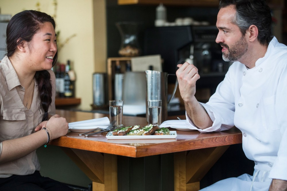 College Kitchenista and Minnesota Daily reporter Yena Lee and Chef Alex Roberts enjoy grilled bread with ricotta at Restaurant Alma on University Avenue on Saturday.