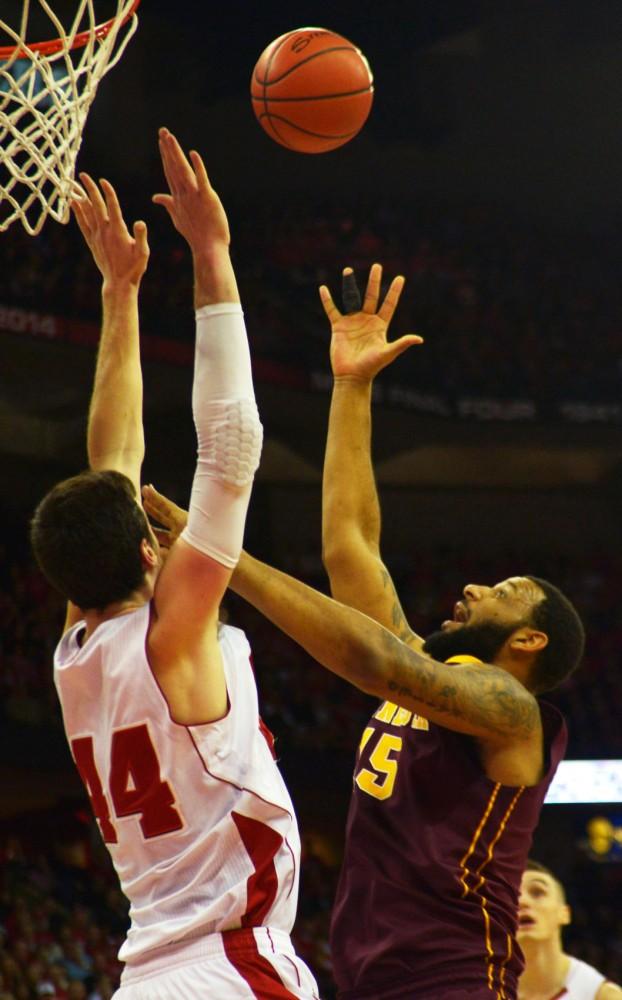 Minnesota guard Mo Walker reaches for arebound in the first half against the Badgers on Feb. 21 in Madison, Wis.