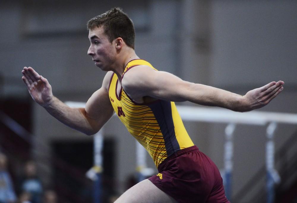 Freshman Joel Gagnon runs swiftly during his floor routine at the Sports Pavilion on Jan. 24.