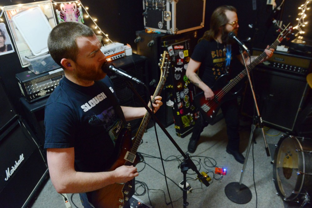 Guitarist Andy Webber and bassist John Henry of the band Nightosaur rehearse on Saturday in Minneapolis. Nightosaur will be playing a show at the Triple Rock Social Club on Friday, March 6th.