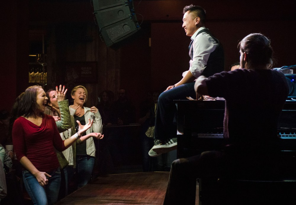 Tom Luong receives a birthday serenade from pianist Terry Boullianne and audience members on Saturday night at The Shout House.