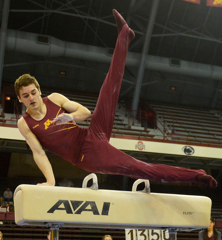Senior Ellis Mannon competes on the pommel horse against Iowa on Saturday at Sports Pavilion.