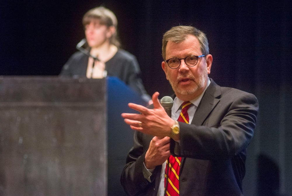 University president Eric Kaler responds to questions at the Faculty Senate's meeting to review the human subject research report on Friday at Coffman Memorial Union . On some of the more negative findings in the report, President Kaler stated