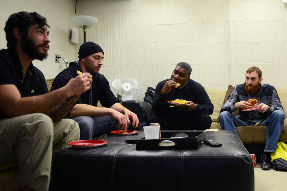Student Veterans Association members enjoy pizza as a part of the student group's Friday lunch tradition in Johnston Hall. The Student Services Fees Committee's initial recommendation for the group cuts some of its budget for the weekly meeting.