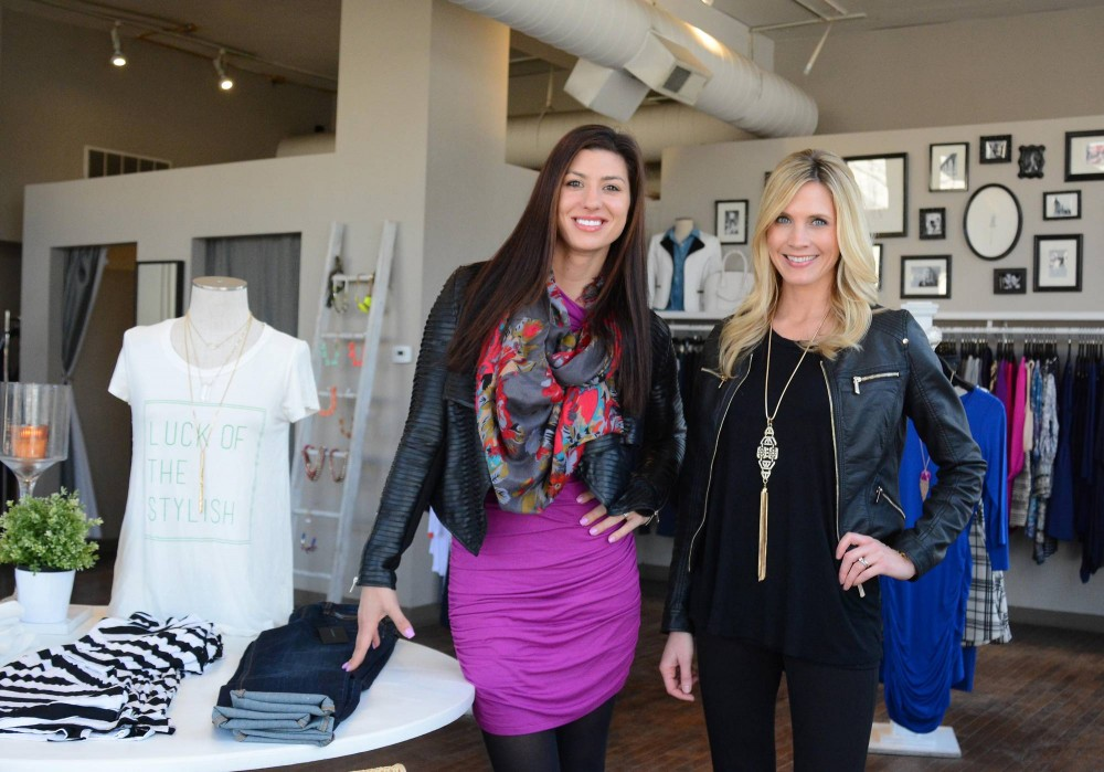 Primp boutique owners Michele Gudmundson and University grad Wesley Uthus at their St. Paul store on Wednesday. The boutique, which offers fashionable items at affordable prices, is just one of six locations in the surrounding area.
