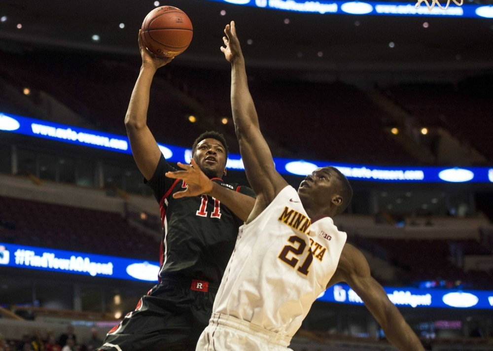 Minnesota's Bakary Konaté blocks Rutgers' Kadeem Jack during the first half of the men's Big Ten basketball tournament in Chicago on Wednesday.